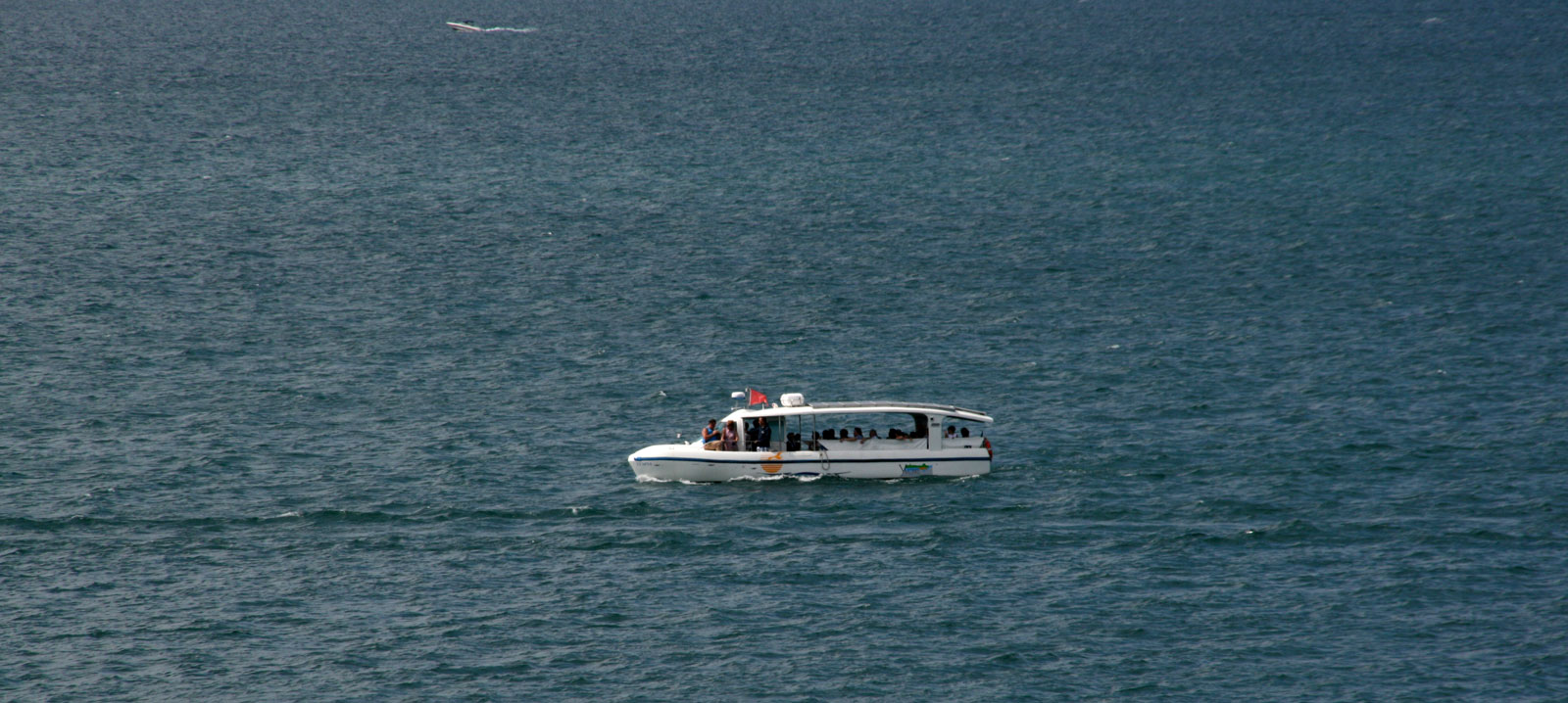 The solar boat on Lake Geneva between Yvoire and Rovorée.